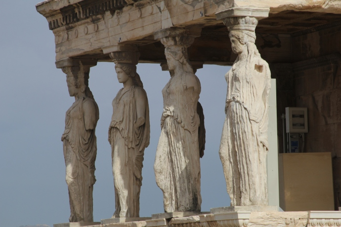 The caryatids of the Erechtheion supporting function as columns supporting the roof structure