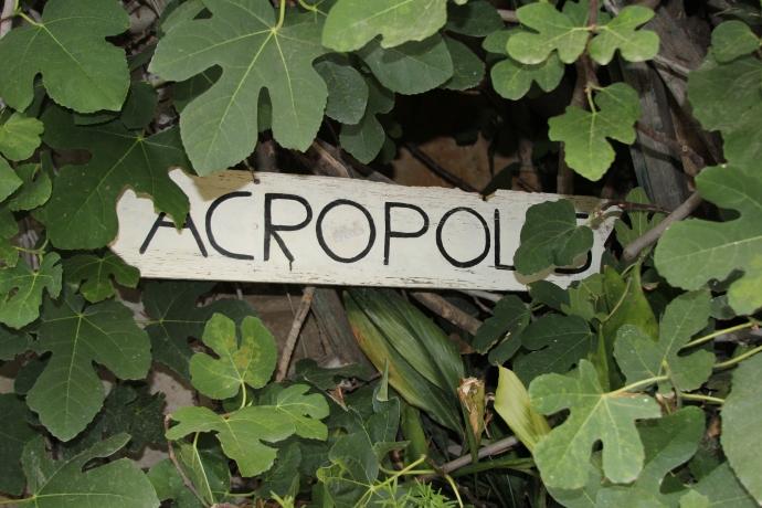 Sign to Acropolis for wayward tourists walking the neighborhood of Anafiotika